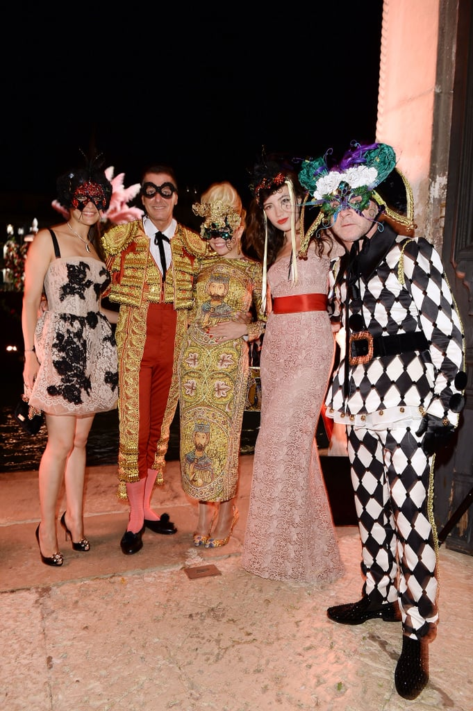 Caterina Murino, Stefano Gabbana, Paloma Faith, Daisy Lowe, and Domenico Dolce embraced the party spirit and one another for a star-packed group shot while feting the label's Alta Moda collection in Venice.