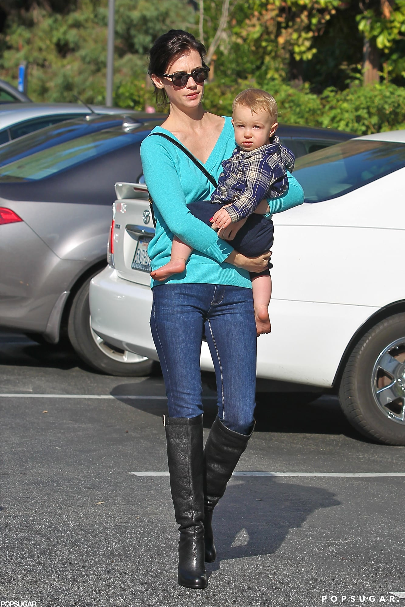 January Jones wore tall boots as she stepped out with Xander Jones.