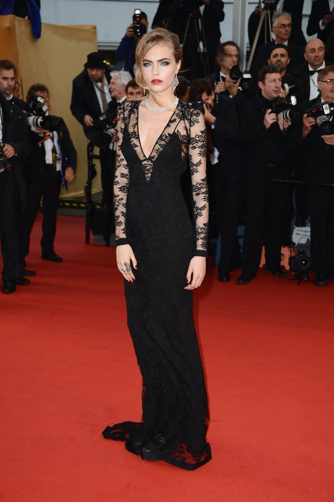 Cara Delevingne proved that she can pull off a fancy gown just as well as she can rock ripped jeans. How so? In a black lace Burberry gown at the 2013 Cannes Film Festival.
