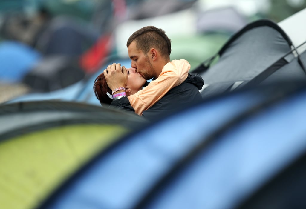 This kissy couple hid among the tents at the Glastonbury festival in the UK.