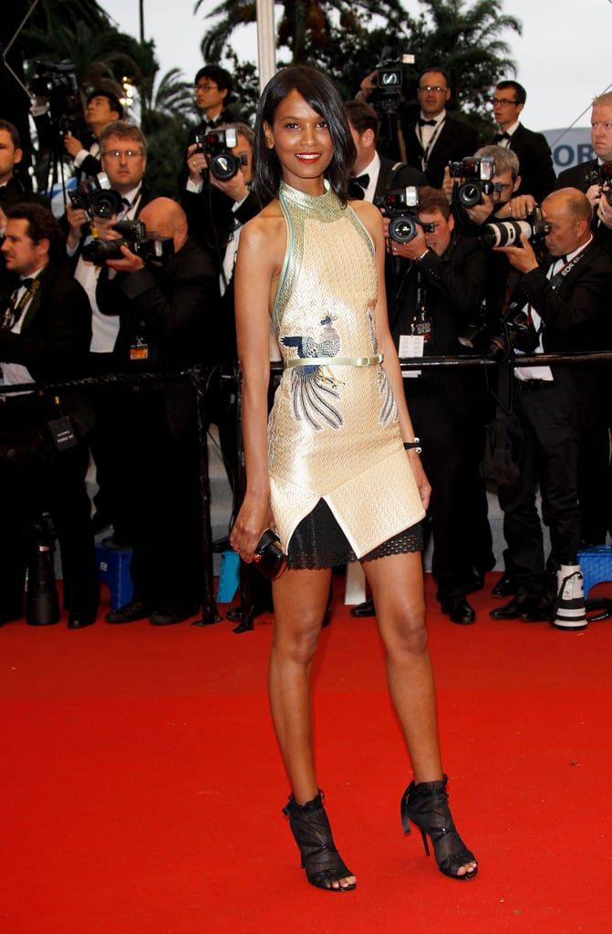 Liya Kebede opted for a metallic halter-style mini and open-toe boots at the Cosmopolis premiere.