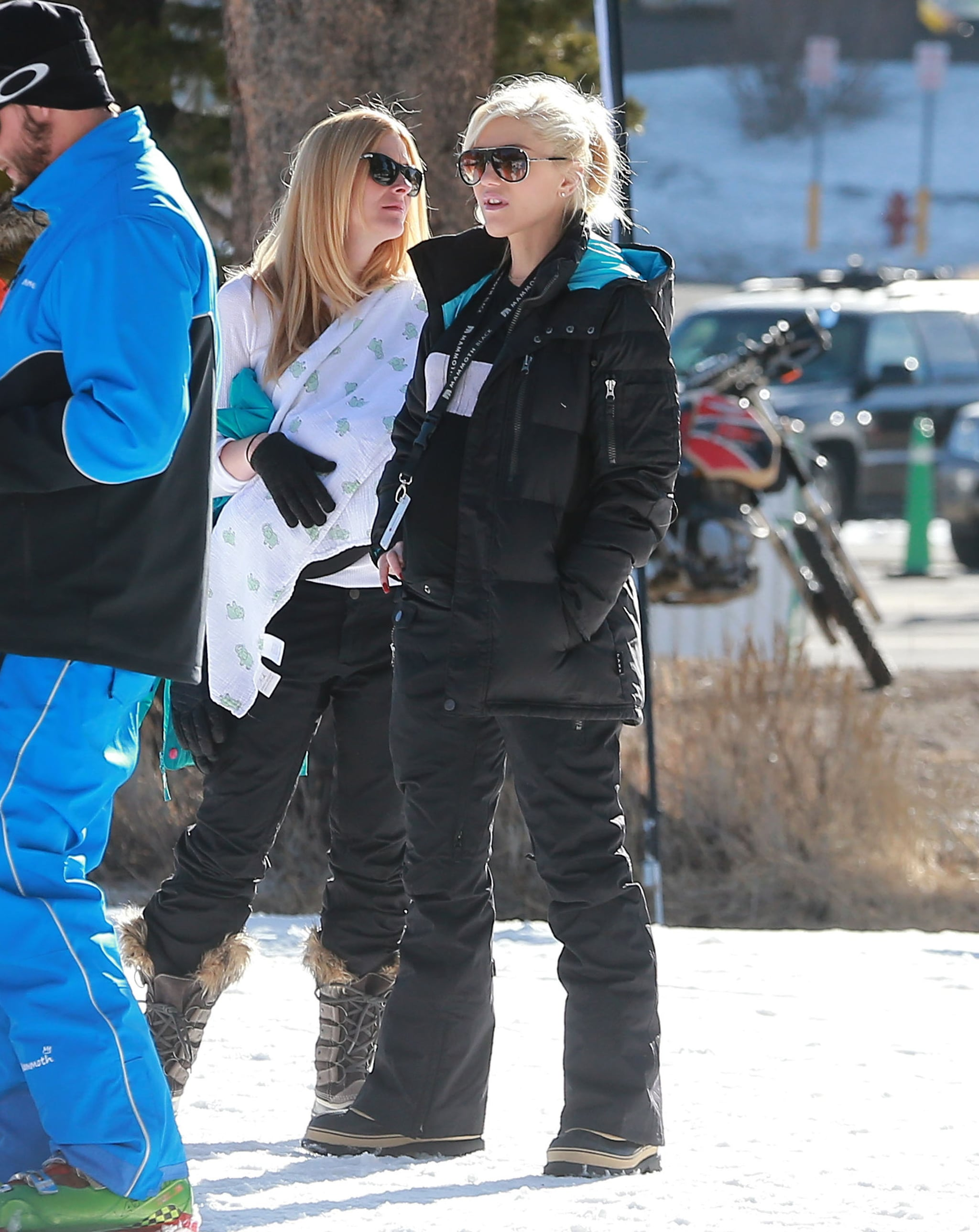 Gwen watched as her sons took ski lessons.