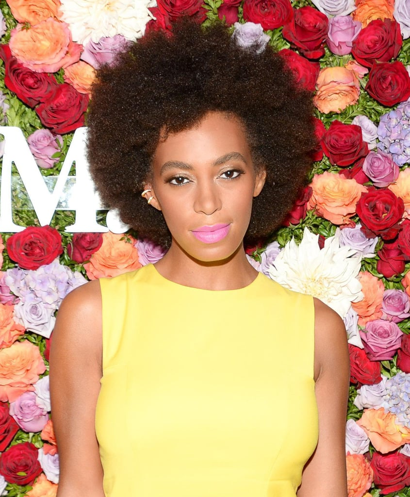 Solange Knowles is known for her love of bright colors, and last night she didn't disappoint, wearing a neon pink lip hue with her signature bold brows and afro.