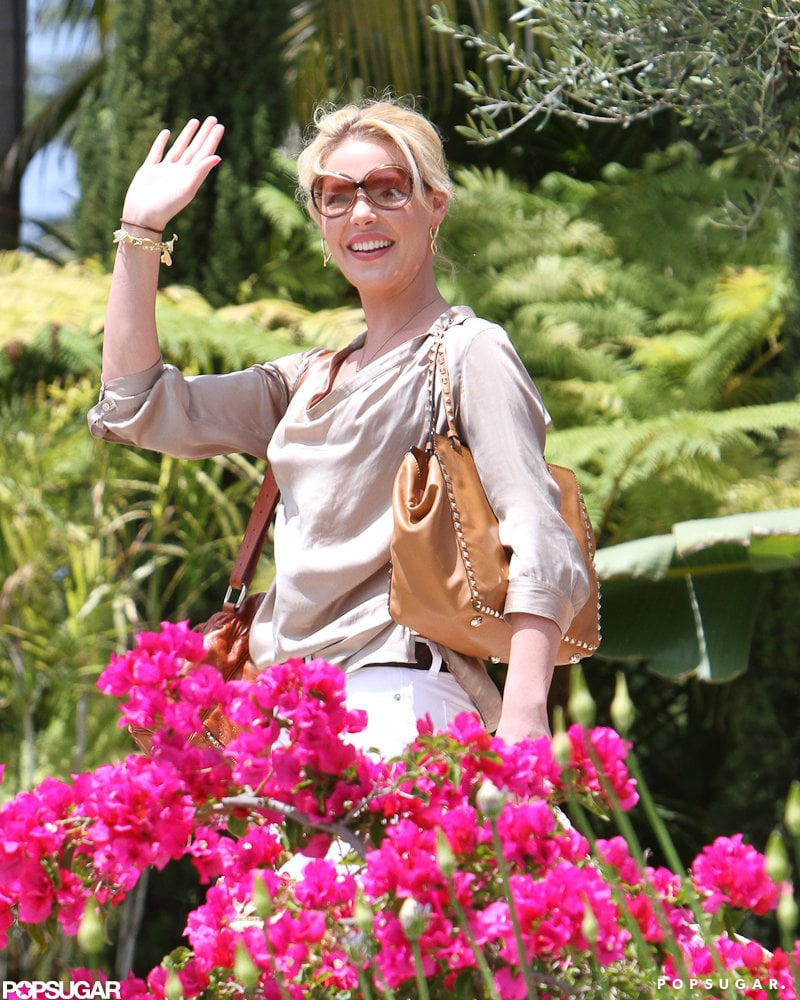 Katherine Heigl waved as she was walking into a friend's house in LA.