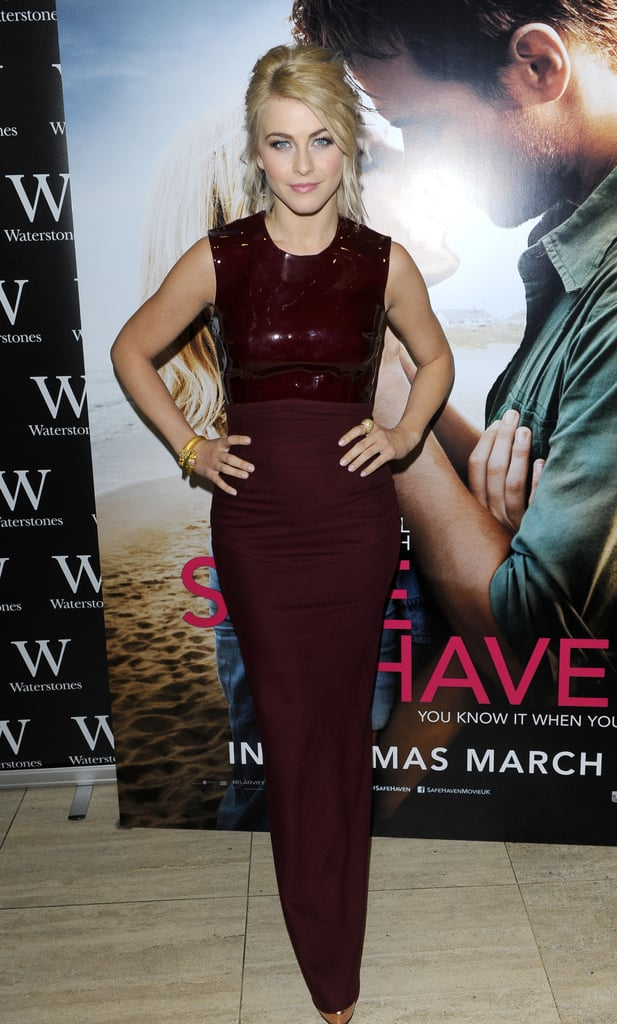 At an evening event with Safe Haven author Nicholas Sparks in London, Julianne showed off her svelte figure in a formfitting dark-red dress by Emilio De La Morena.