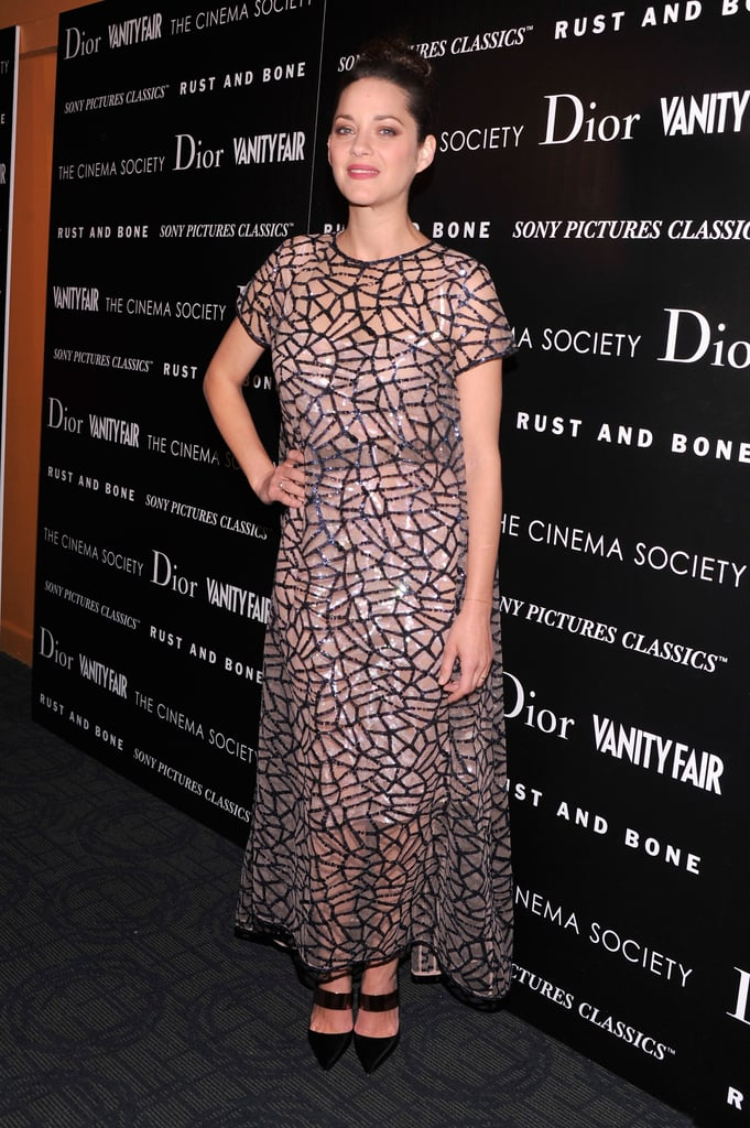 Marion Cotillard's sheer Christian Dior dress from the Spring 2013 collection was a vision. The web-like sequins were mesmerizing.