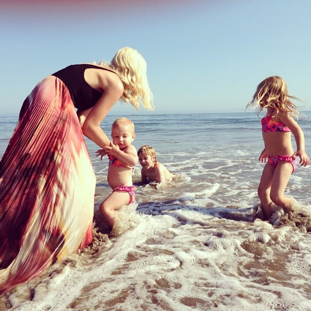 """Tori Spelling hit the beach with her tots on Mother's Day, saying, """"Who said a gown isn't appropriate swimwear... #momista #momwarrior #mothersday"""" Source: Instagram user torianddean"""