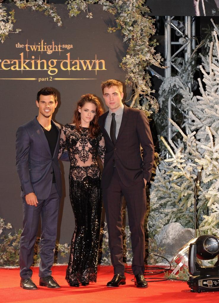 Taylor Lautner, Kristen Stewart, and Robert Pattinson posed at the UK premiere of Breaking Dawn Part 2.