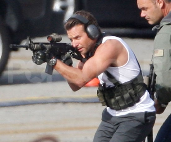 Slide Photo of Bradley Cooper Shooting a Gun on A Team Set in Canada
