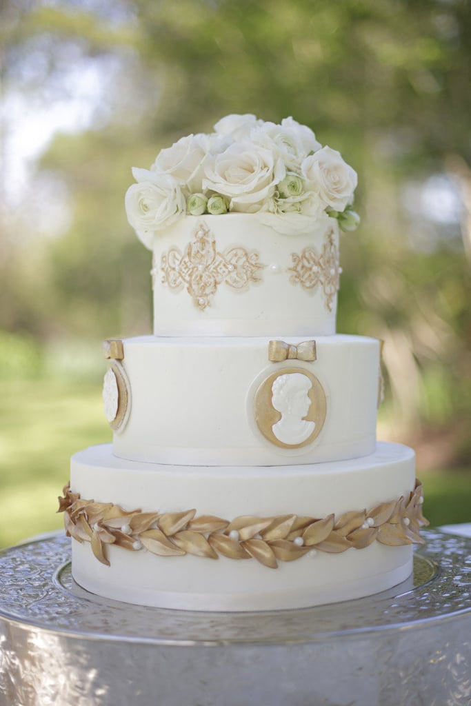 The great thing about this gold-detailed cake is that it reflects another time period but is still totally appropriate for a modern-day wedding.