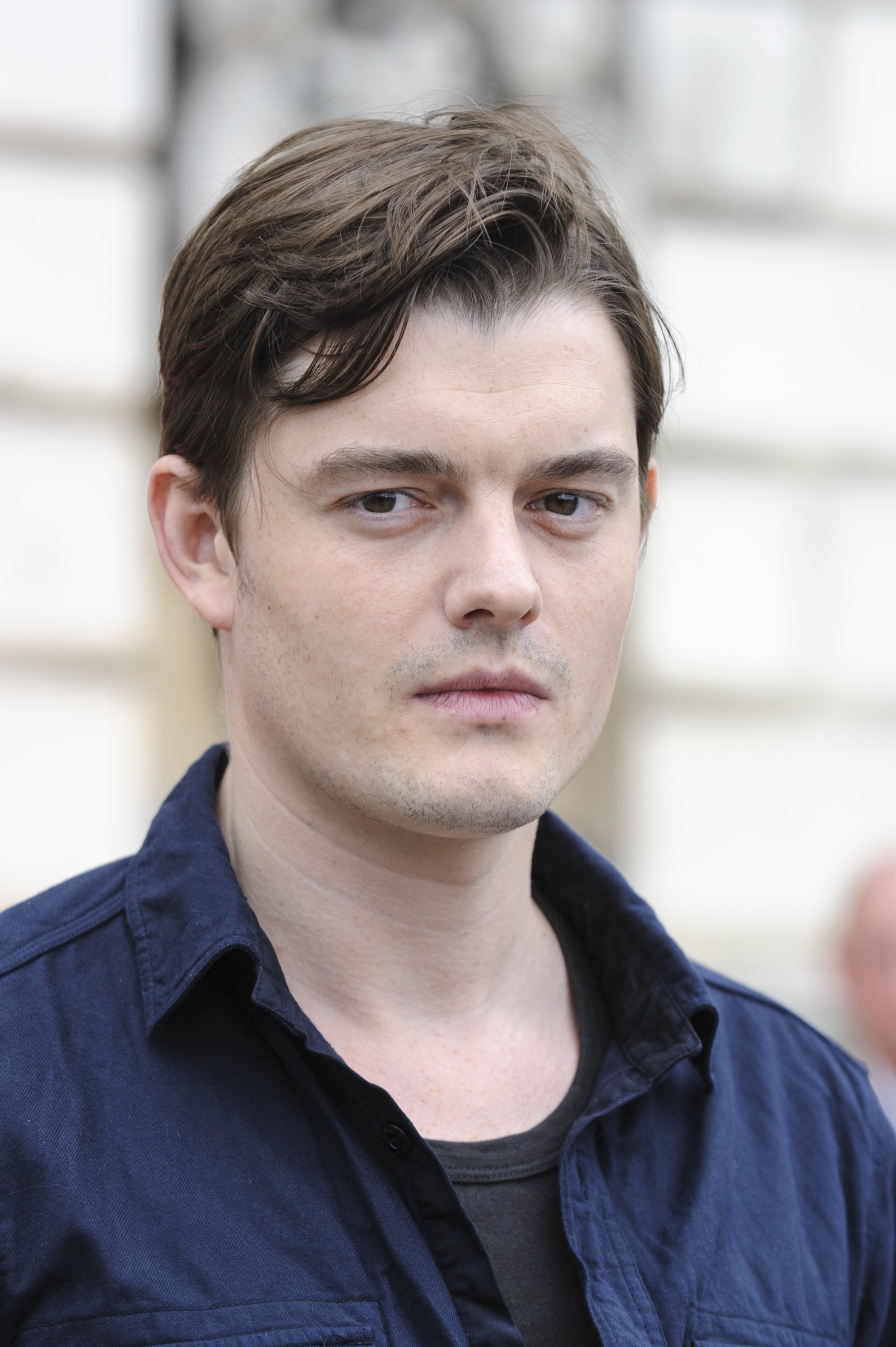 Sam Riley parted his brown hair.
