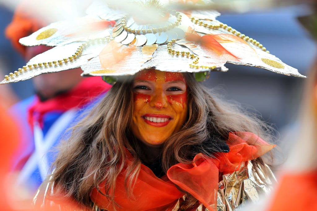 A Karneval-goer smiled in Cologne, Germany, where revelers wore homemade costumes.