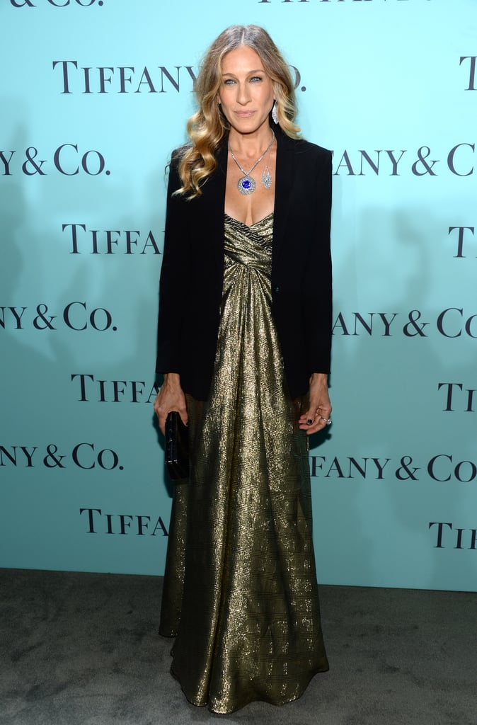 SJP dazzled in a vintage Vicky Tiel gold strapless gown topped with a black blazer by Yeojin Bae at the Tiffany & Co. Blue Book Ball in NYC. She accessorized her shimmering ensemble with even more sparkle — round fringe earrings, a round fringe necklace, a round tanzanite and diamond drop pendant, round tanzanite diamond earrings, and a round tanzanite and diamond ring — all from the 2013 Blue Book Collection.