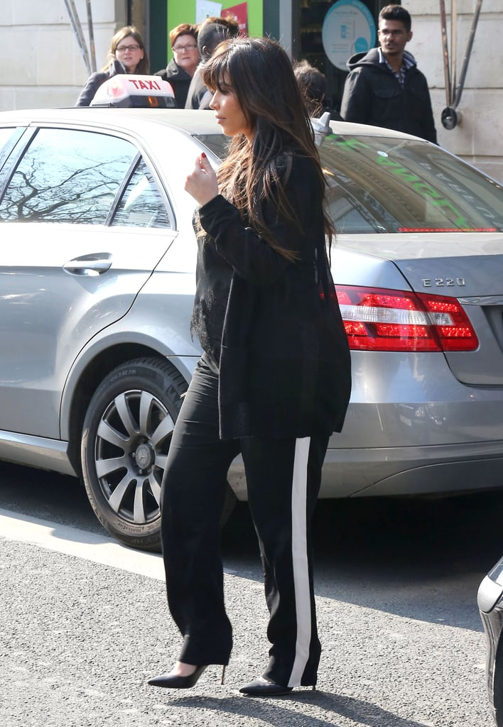 Kim Kardashian sported black pants with a white stripe.