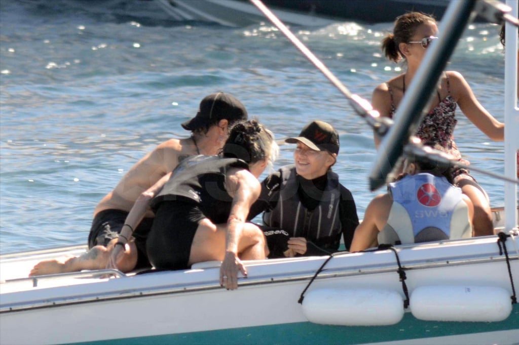 Madonna hangs out in France in a wetsuit.