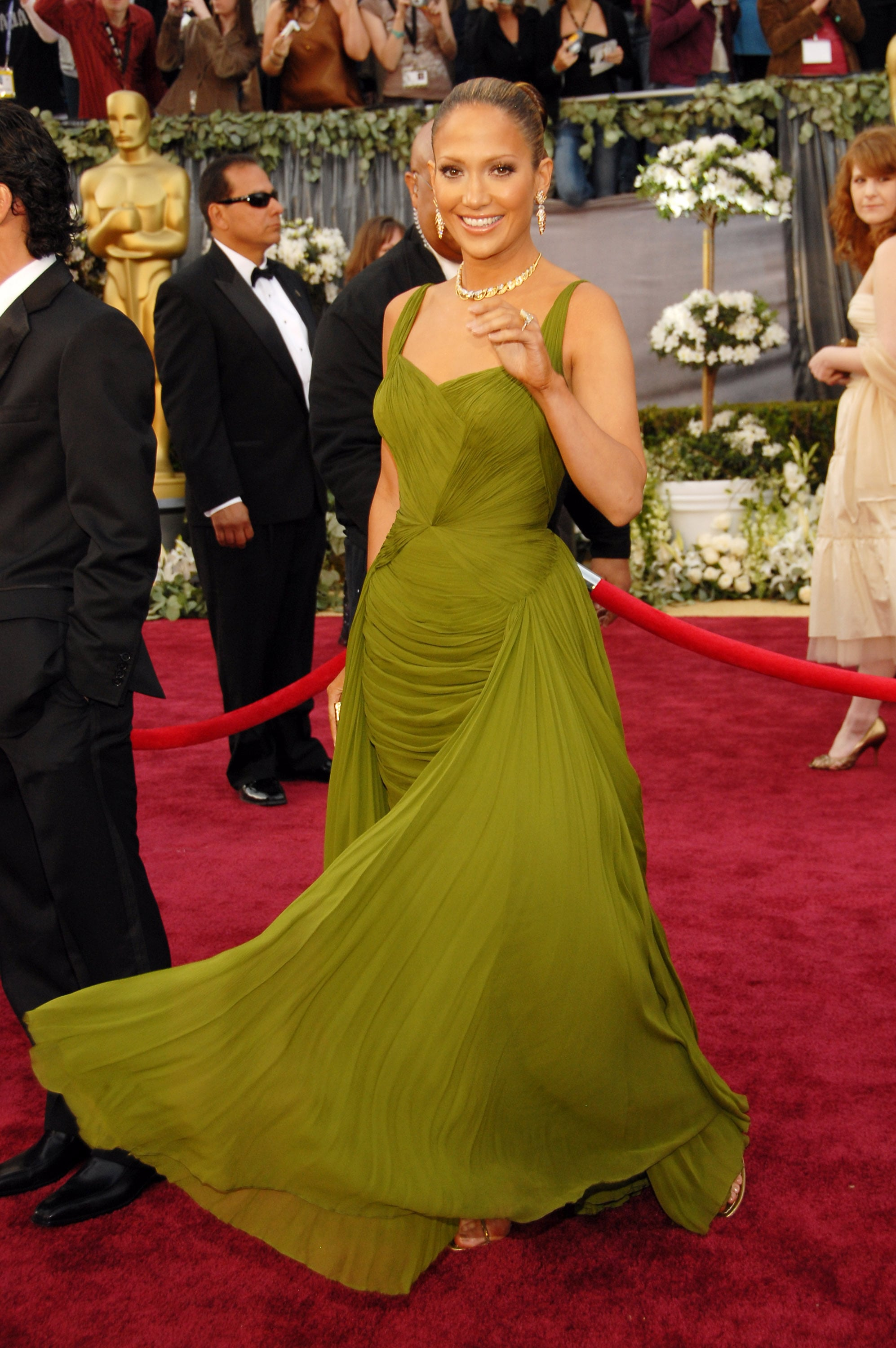 A memorable moment in an olive-hued chiffon gown at the Academy Awards in 2006.