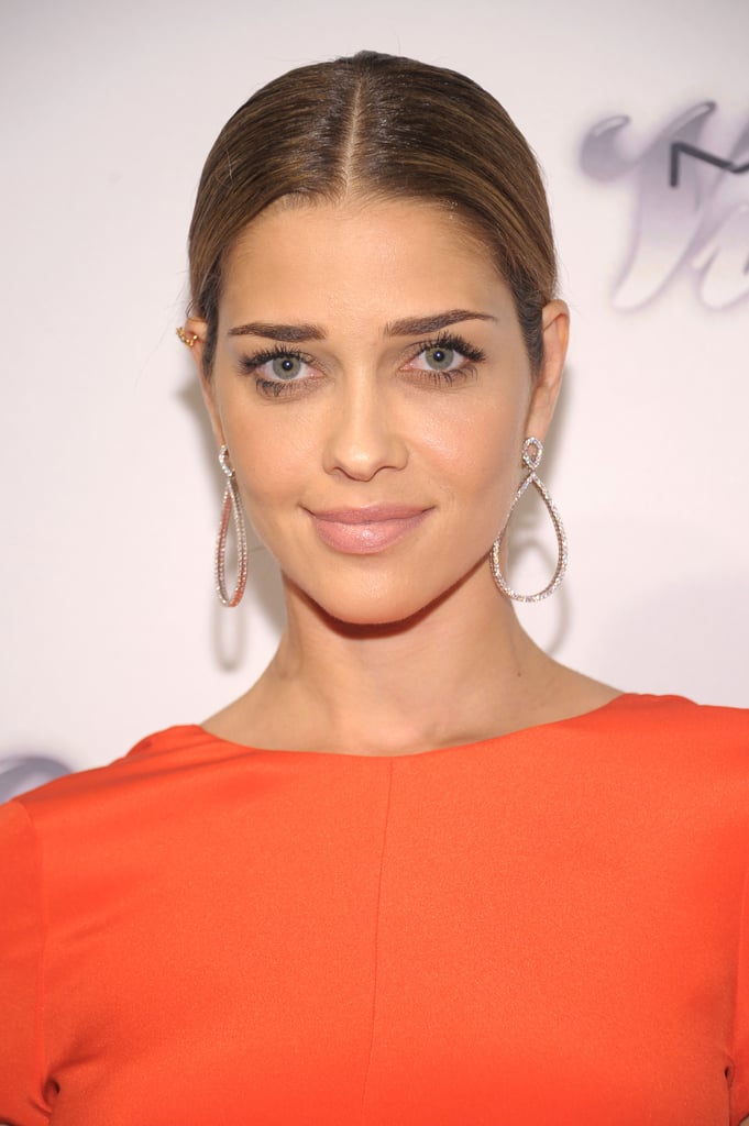 Model Ana Beatriz Barros's middle part drew attention to her bold brows, lush lashes, and a tinted pink lip hue.