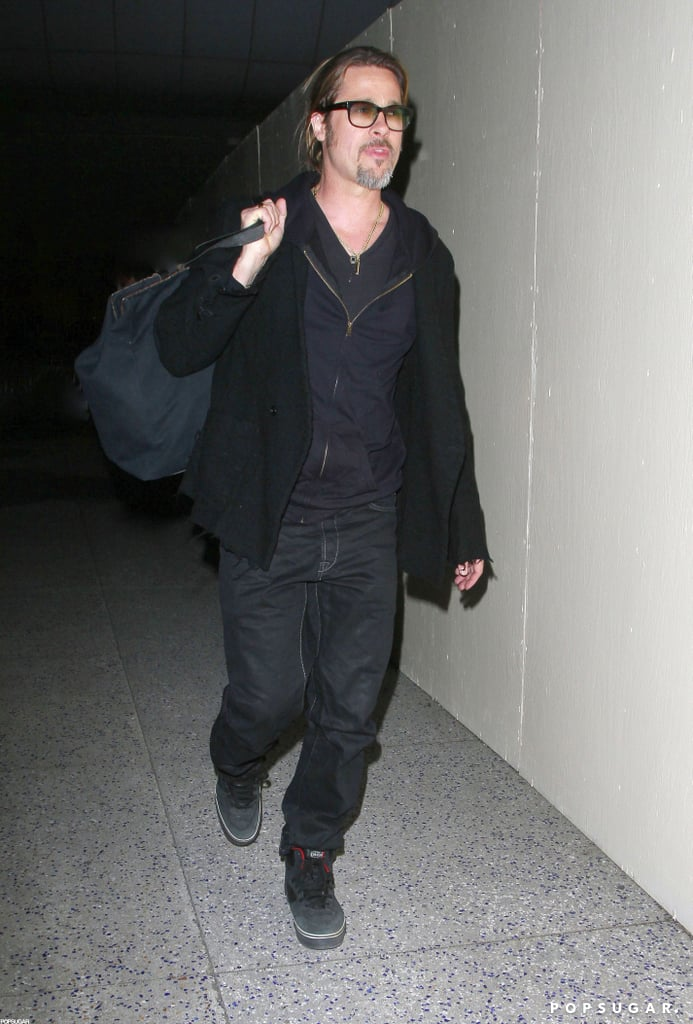 Brad Pitt wore black sneakers and an all-black ensemble to travel to LAX.