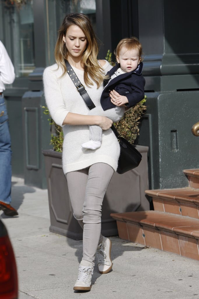 Jessica swapped her layered style for a white cashmere sweater, putty-hued denim, and white high-top sneakers in LA.