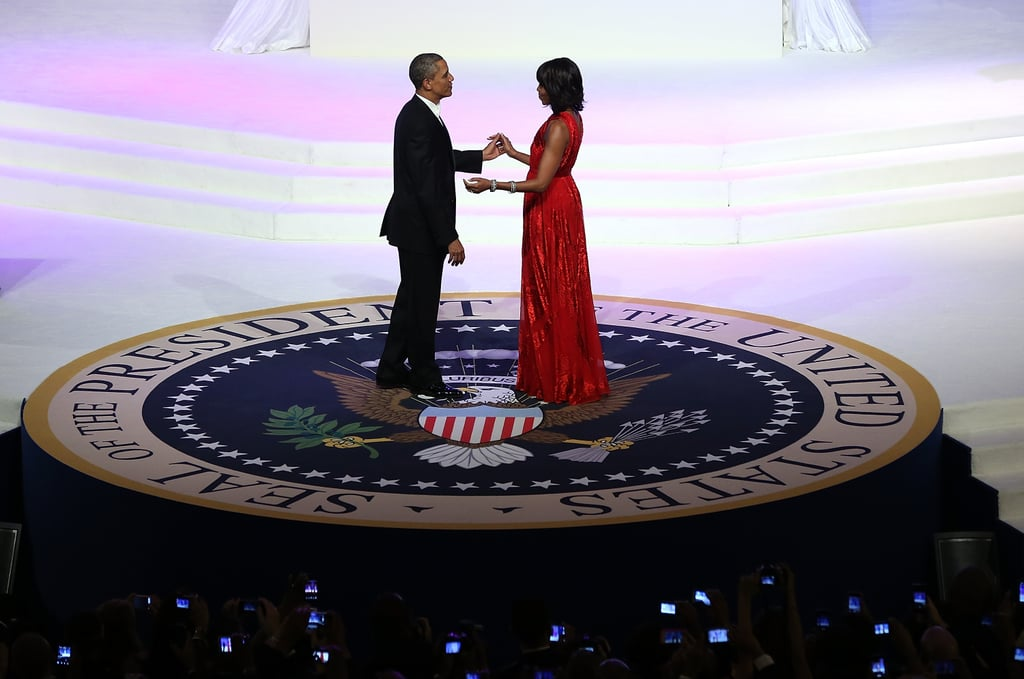 A view of the couple mid-dance in the center of the presidential seal — what a gorgeous floor-length silhouette.