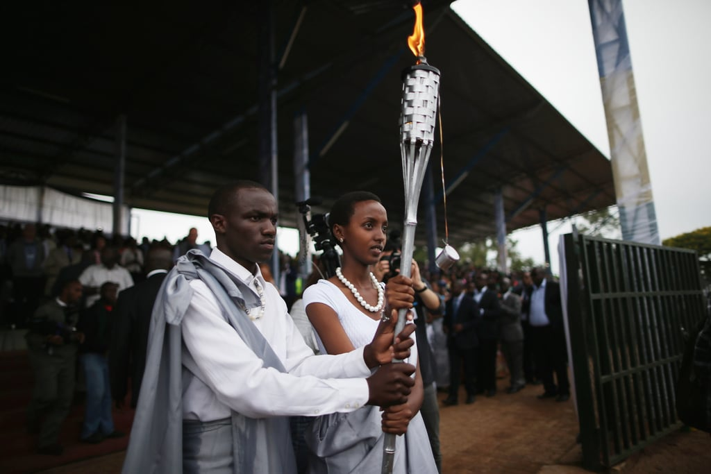 Torchbearers carried the Kwibuka Flame of Remembrance in the city of Kigali on April 5. The flame's journey would end at Kigali's national genocide memorial today.