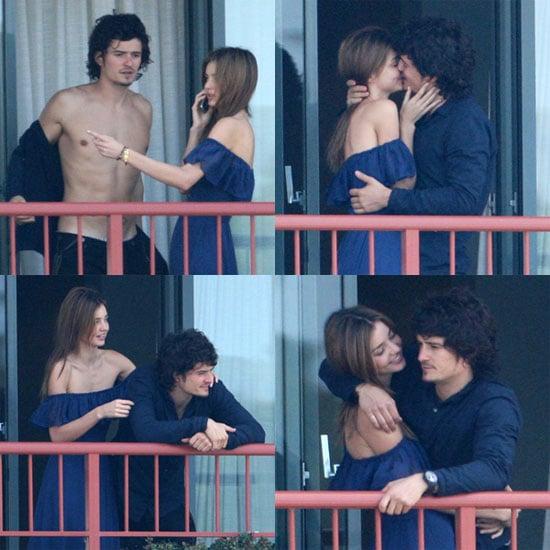 Photos of Shirtless Orlando Bloom Kissing Miranda Kerr on a Balcony in Australia