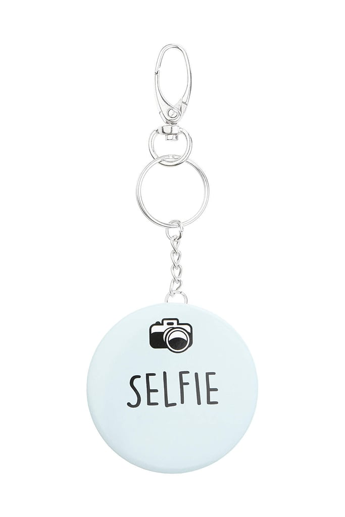 """Since there's no one else you'd rather take a selfie with, gift her this """"selfie"""" keychain ($9), so she thinks of you every time she sees it."""