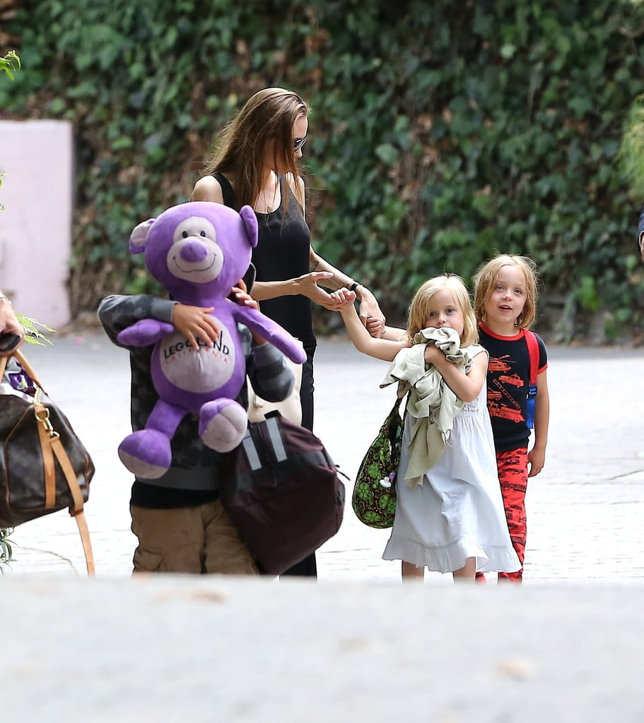 Angelina Jolie held her twins' hands as the group walked through Santa Barbara.
