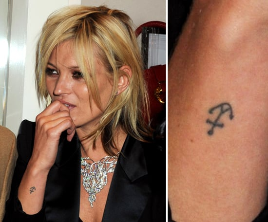 Kate Moss has a small anchor tattooed on the outside of her right wrist.
