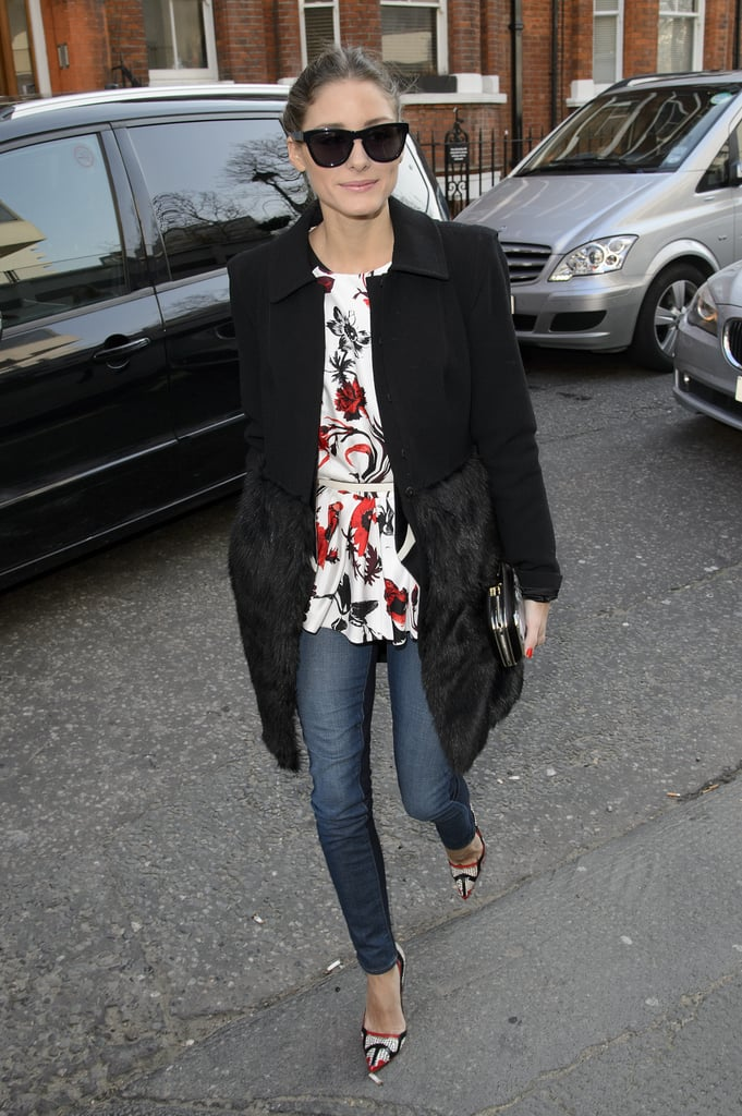 Olivia Palermo brightened up her LFW wardrobe with a floral peplum top and red printed pumps on her way into the Anya Hindmarch show. A fur-trim coat was a chic finish.