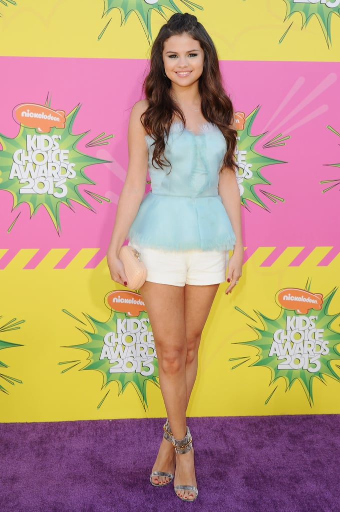 For the Kids' Choice Awards in March, Selena went head-to-toe designer: she showed off her stems in white shorts and a light blue peplum top by Oscar de la Renta, and paired the look with Gucci's snakeskin ankle-strap Ursula heels ($685). To finish, she carried a Diane von Furstenberg clutch and kept her hair in a retro half-up 'do.