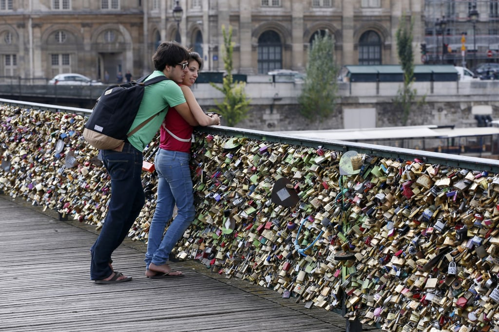 A couple got romantic next to the love-lock-covered Pont des Arts bridge.