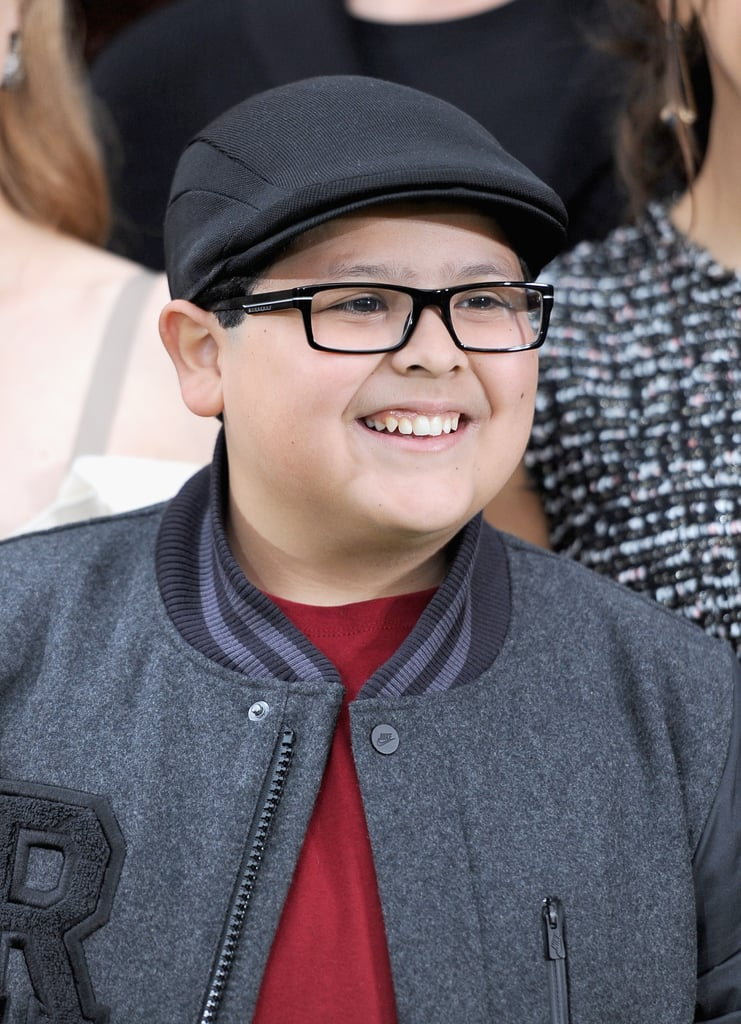 Rico Rodriguez smiled for photos.