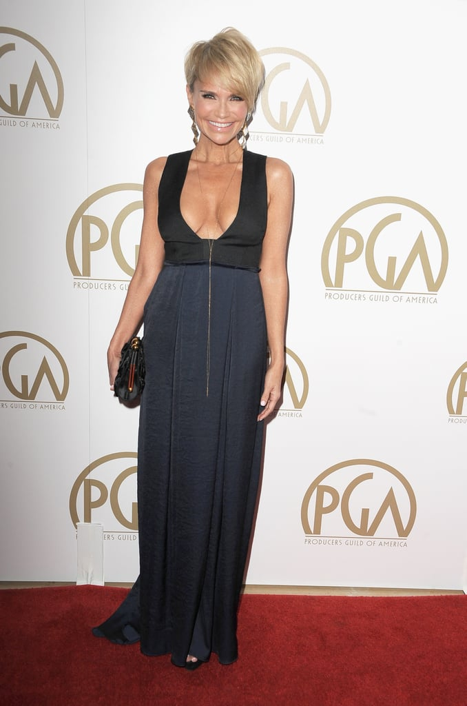 Kristin Chenoweth wore a floor-length gown with a plunging neckline.