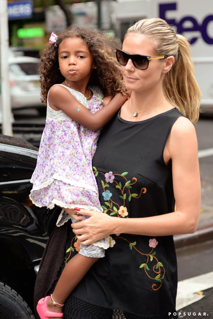 Heidi Klum carried her daughter Lou Samuel while shopping in NYC.