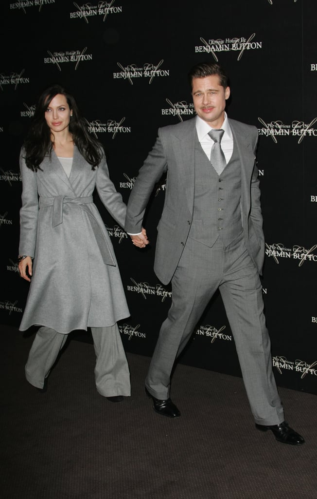 Angelina Jolie and Brad Pitt wore matching shades of gray at his Paris premiere of The Curious Case Of Benjamin Button in January 2009.