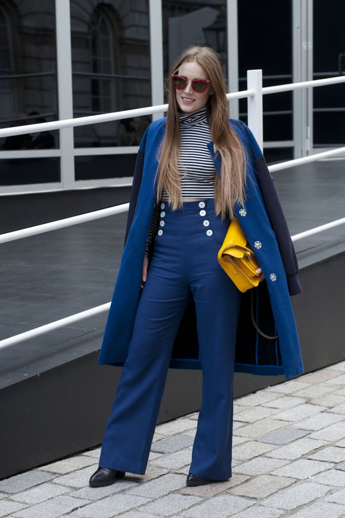A nautical-inspired bit of street style, thanks to high-waisted sailor pants and stripes.