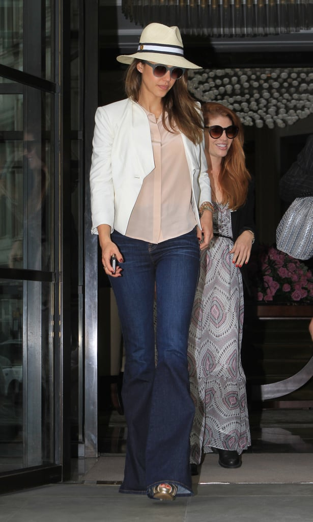 Jessica's travel style toes the fashion-meets-function line perfectly, as proved by her Heathrow look — crisp white blazer, wide-leg denim trousers, her go-to Tory Burch fedora, and acetate shades.
