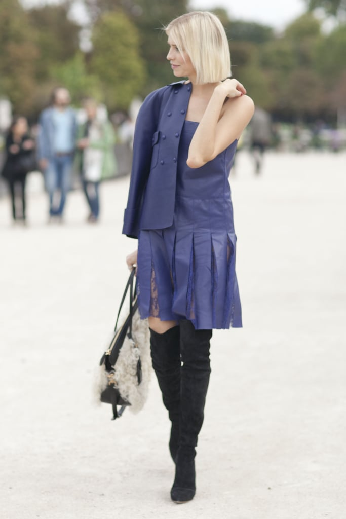 Elena Perminova traded typical heels for over-the-knee boots.