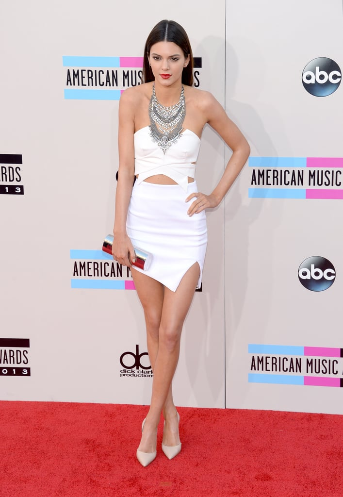 Presenter Kendall Jenner showcased her model frame in a white cutout mini and one heck of a statement necklace.