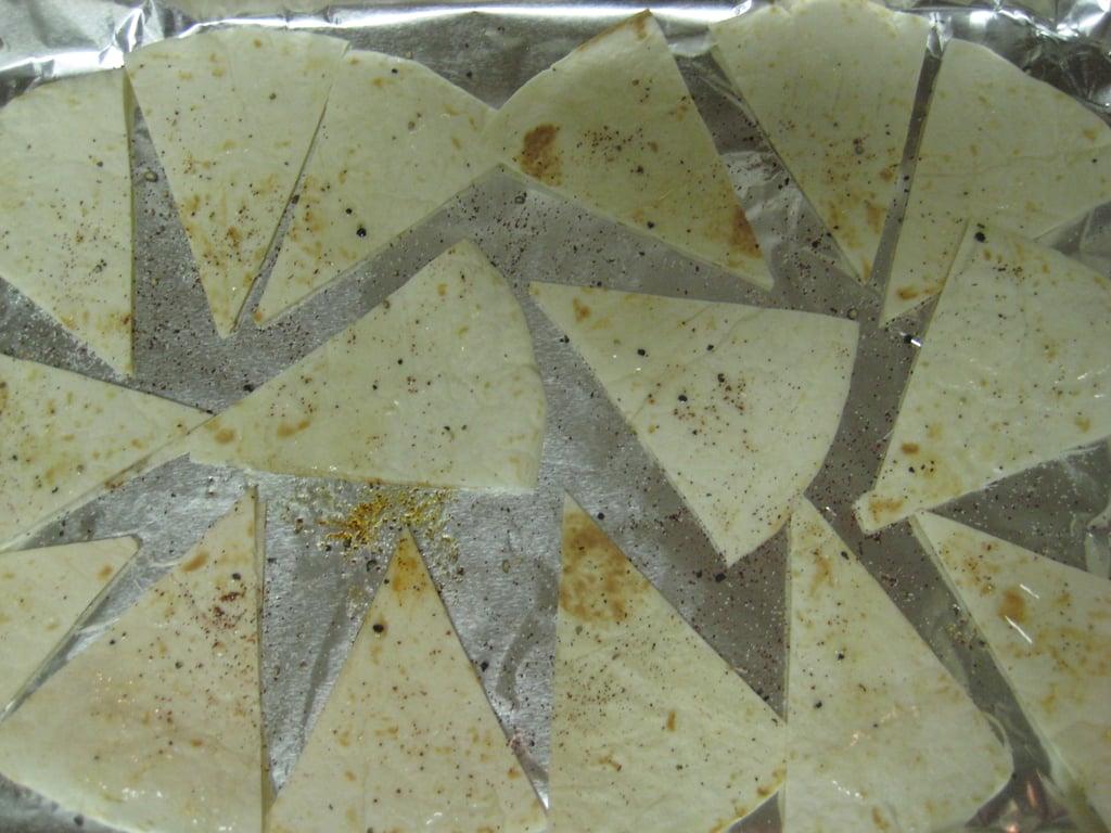 Seasoning the tortillas.