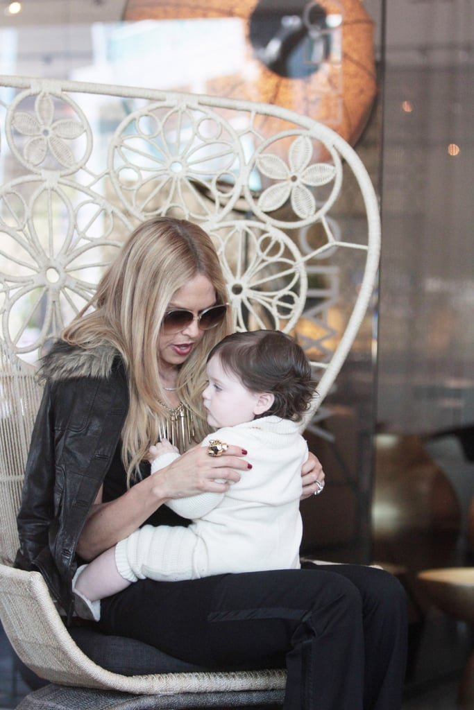 Rachel Zoe sat down with baby Skyler on her lap.