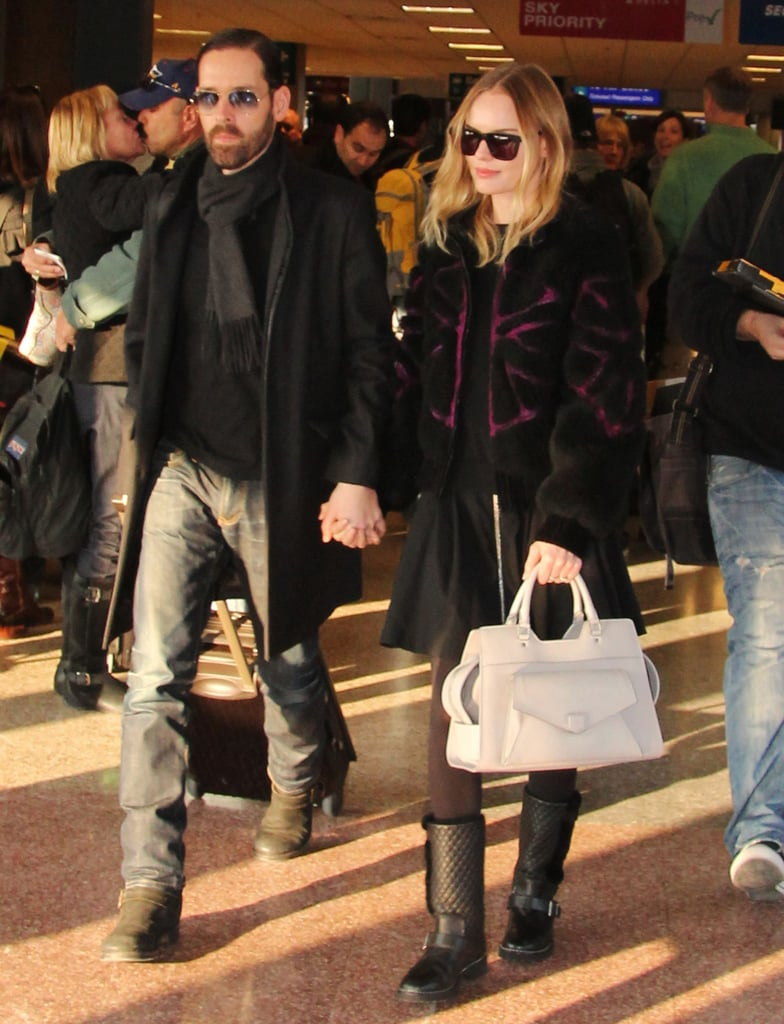 Styling a fuchsia and black fur jacket, quilted moto boots, and a sleek white satchel, Kate Bosworth touched down in Salt Lake City looking très chic, per usual.