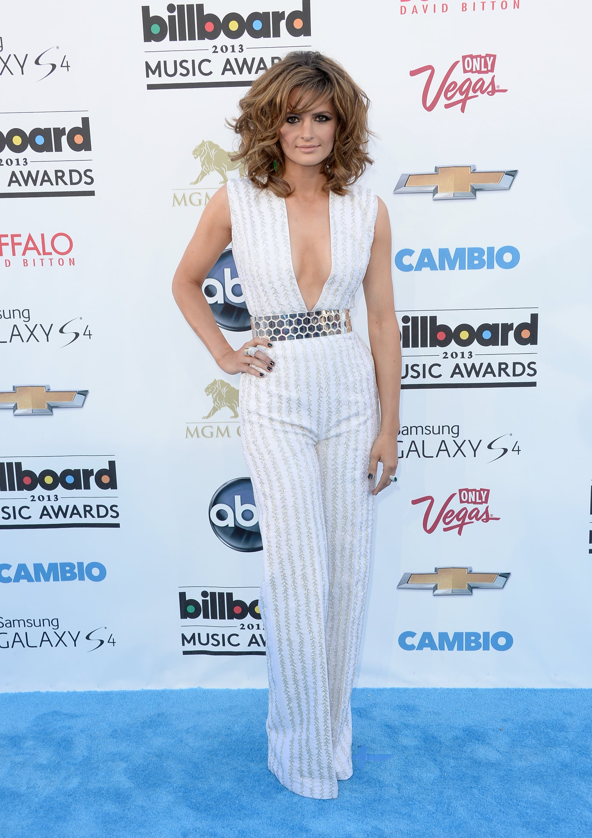 Stana Katic took a major plunge in a white striped jumpsuit, complete with a silver metallic belt.