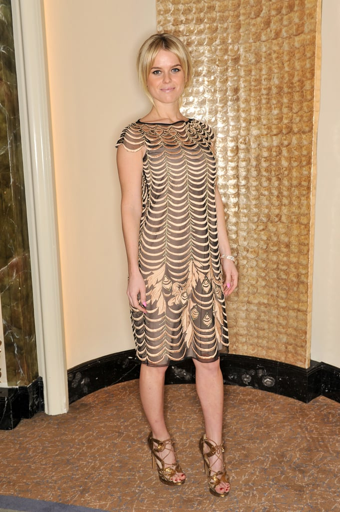 Alice Eve attended Temperley London in a fancier ensemble, including a gold dress and matching gold sandals.
