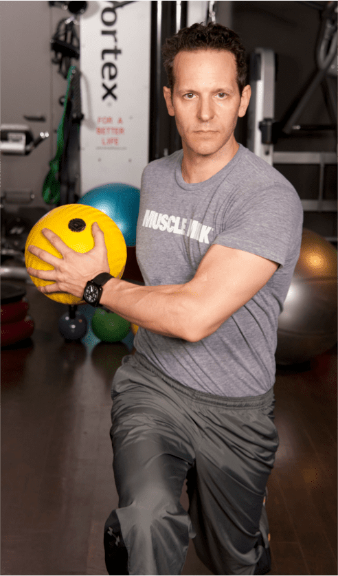Continue alternating until you have done five repetitions on each side, squeezing the ball with both hands to engage your arms and chest.