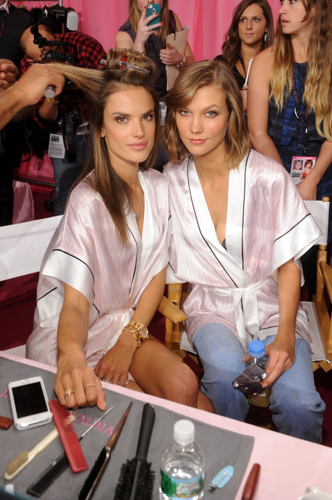 Alessandra Ambrosio sat by Karlie Kloss while getting her hair styled.
