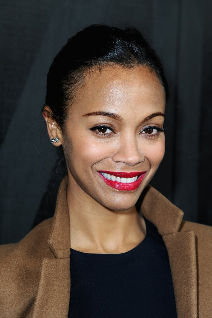 During Paris Fashion Week this past March, Zoe looked chic in a low ponytail with bright red lipstick.