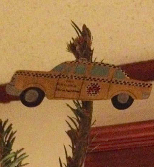 Why We Crown Our Tree with a Taxi