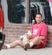 Adam Sandler gave his dog a belly rub while sitting on the sidewalk in LA on Sunday.